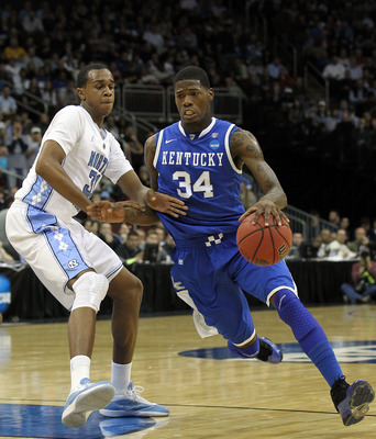 NEWARK, NJ - MARCH 27:  DeAndre Liggins #34 of the Kentucky Wildcats in action against John Henson #31 of the North Carolina Tar Heels during the east regional final of the 2011 NCAA men's basketball tournament at Prudential Center on March 27, 2011 in Ne