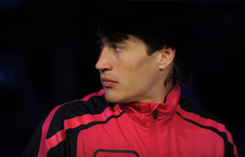 MADRID, SPAIN - APRIL 16: Bojan Krkic of Barcelona waits in the substitutes bench before the start of  the La Liga match between Real Madrid and Barcelona at Estadio Santiago Bernabeu on April 16, 2011 in Madrid, Spain.  (Photo by Denis Doyle/Getty Images