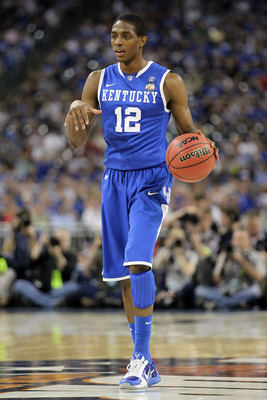 HOUSTON, TX - APRIL 02:  Brandon Knight #12 of the Kentucky Wildcats moves the ball while taking on the Connecticut Huskies during the National Semifinal game of the 2011 NCAA Division I Men's Basketball Championship at Reliant Stadium on April 2, 2011 in