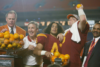 MIAMI - JANUARY 2:  (L-R) Alfonso Cueto, Immediate Past President of the Orange Bowl committee, head coach Pete Carroll, Troy Polamalu #43, Carson Palmer #3 and Athletic Director Mike Garrett of USC celebrate the victory over Iowa in the FedEx Orange Bowl