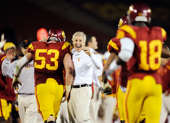 LOS ANGELES, CA - NOVEMBER 28:  Pete Carroll (C) of the USC Trojans celebrates with Jeff Byers #53 after Damian Williams #18 wide receiver of the USC Trojans scored a 48-yard touchdown pass after UCLA Bruins called a time out with one minute remaining in