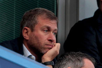 LONDON, ENGLAND - AUGUST 14:  Chelsea owner Roman Abramovich (L) looks on during the Barclays Premier League match between Chelsea and West Bromwich Albion at Stamford Bridge on August 14, 2010 in London, England.  (Photo by Phil Cole/Getty Images)