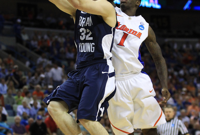 NEW ORLEANS, LA - MARCH 24:  Jimmer Fredette #32 of the Brigham Young Cougars shoots over Kenny Boynton #1 of the Florida Gators in the second half during the Southeast regional of the 2011 NCAA men's basketball tournament at New Orleans Arena on March 24