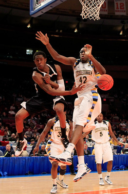 NEW YORK, NY - MARCH 08: Marshon Brooks #2 of the Providence Friars passes the ball against Chris Otule #42 of the Marquette Golden Eagles during the first round of the 2011 Big East Men's Basketball Tournament presented by American Eagle Outfitters at Ma