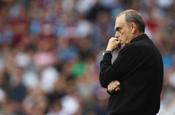 LONDON, ENGLAND - SEPTEMBER 11:  Avram Grant manager of West Ham United looks thoughtful during the Barclays Premier League match between West Ham United and Chelsea at the Boleyn Ground on September 11, 2010 in London, England.  (Photo by Hamish Blair/Ge
