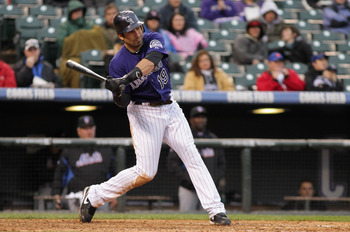 DENVER, CO - MAY 12:  Ryan Spilborghs #19 of the Colorado Rockies takes an at bat New York Mets at Coors Field on May 12, 2011 in Denver, Colorado.  (Photo by Doug Pensinger/Getty Images)