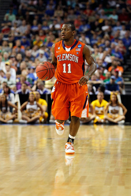 TAMPA, FL - MARCH 17:  Andre Young #11 of the Clemson Tigers brings the ball up court against the West Virginia Mountaineers during the second round of the 2011 NCAA men's basketball tournament at St. Pete Times Forum on March 17, 2011 in Tampa, Florida.