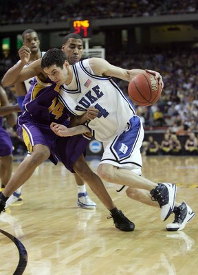ATLANTA - MARCH 23:  J.J. Redick #4 of the Duke Blue Devils dribbles against Garrett Temple #14 of the LSU Tigers during third round game of the 2006 NCAA Division I Men's Basketball Tournament Regional at the Georgia Dome on March 23, 2006 in Atlanta, Ge