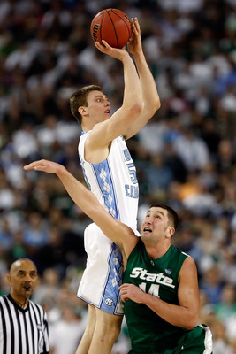 DETROIT - APRIL 06:  Tyler Hansbrough #50 of the North Carolina Tar Heels goes up for a shot over Goran Suton #14 of the Michigan State Spartans in the first half during the 2009 NCAA Division I Men's Basketball National Championship game at Ford Field on