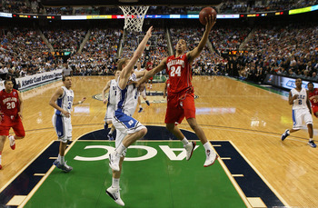 GREENSBORO, NC - MARCH 11:  Cliff Tucker #24 of the Maryland Terrapins shoots against Mason Plumlee #5 of the Duke Blue Devils during the quarterfinals of the 2011 ACC men's basketball tournament at the Greensboro Coliseum on March 11, 2011 in Greensboro,