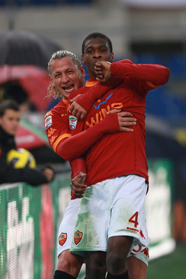 ROME, ITALY - DECEMBER 12:  Juan (R) with his teammate Philippe Mexes of AS Roma celebrates after scoring the opening goal during the Serie A match between AS Roma and AS Bari at Stadio Olimpico on December 12, 2010 in Rome, Italy.  (Photo by Paolo Bruno/