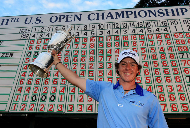 BETHESDA, MD - JUNE 19:  Rory McIlroy of Northern Ireland poses with the trophy after his eight-stroke victory on the 18th green during the 111th U.S. Open at Congressional Country Club on June 19, 2011 in Bethesda, Maryland.  (Photo by David Cannon/Getty