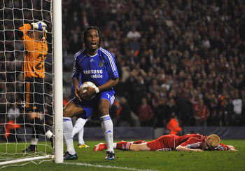 LIVERPOOL, UNITED KINGDOM - APRIL 22:  Didier Drogba of Chelsea retrieves the ball after John Arne Riise of Liverpool scored an own goal during the UEFA Champions League Semi Final, first leg match between Liverpool and Chelsea at Anfield on April 22, 200