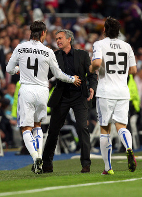 MADRID, SPAIN - APRIL 05:  Jose Mourinho of Real Madrid reacts to Sergio Ramos after Emmanuel Adebayor scores the opener the UEFA Champions League Quarter Final first leg match between Real Madrid and Tottenham Hotspur at Estadio Santiago Bernabeu on Apri