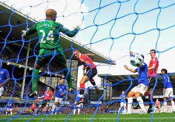 LIVERPOOL, ENGLAND - SEPTEMBER 11:  Nemanja Vidic of Manchester United scores to make it 2-1 during the Barclays Premier League match between Everton and Manchester United at Goodison Park on September 11, 2010 in Liverpool, England.  (Photo by Michael Re