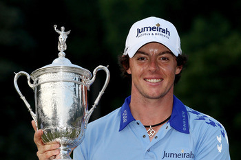 BETHESDA, MD - JUNE 19:  Rory McIlroy of Northern Ireland poses with the trophy after his eight-stroke victory on the 18th green during the 111th U.S. Open at Congressional Country Club on June 19, 2011 in Bethesda, Maryland.  (Photo by Andrew Redington/G