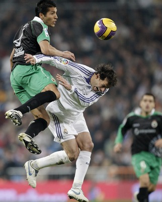 MADRID, SPAIN - DECEMBER 01:  Ruud van Nistelrooy (R) of Real Madrid duels for the ball with Ezequiel Garay of Racing Santander during the La Liga match between Real Madrid and Racing Santander at the Santiago Bernabeu Stadium on December 1, 2007 in Madri