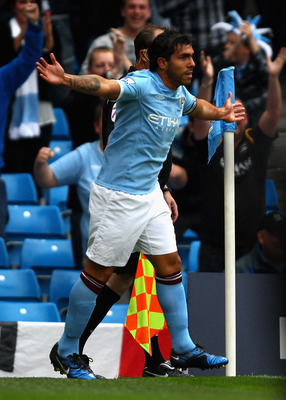 MANCHESTER, ENGLAND - MAY 17:  Carlos Tevez of Manchester City celebrates after scoring the first goal during the Barclays Premier League match between Manchester City and Stoke City at City of Manchester Stadium on May 17, 2011 in Manchester, England.  (