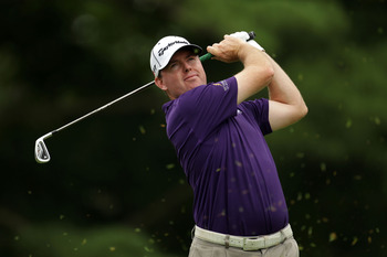 BETHESDA, MD - JUNE 19:  Robert Garrigus hits his tee shot on the second hole during the final round of the 111th U.S. Open at Congressional Country Club on June 19, 2011 in Bethesda, Maryland.  (Photo by Ross Kinnaird/Getty Images)