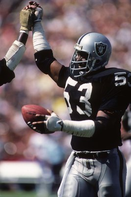 LOS ANGELES - SEPTEMBER 11:  Tight End Rod Martin #53 of the Los Angeles Raiders celebrates with teammates during the game against Houston Oilers at the Los Angeles Memorial Coliseum on September 11, 1983 in Los Angeles, California.  The Raiders won 20-6.
