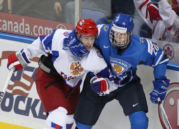BUFFALO, NY - JANUARY 02: Joel Armia #20 of Finland grabs Sergei Kalinin #21 of Russia during the 2011 IIHF World U20 Championship game between Finland and Russia on January 2, 2011 in Buffalo, New York.Russia won 4-3 in overtime.(Photo by Rick Stewart/Ge