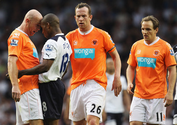 LONDON, UNITED KINGDOM - MAY 07:  Stephen Crainey of Blackpool clashes with Jermain Defoe of Spurs during the Barclays Premier League match between Tottenham Hotspur and Blackpool at White Hart Lane on May 7, 2011 in London, England.  (Photo by Scott Heav