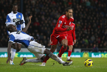 BLACKBURN, ENGLAND - JANUARY 05:  Glen Johnson of Liverpool moves away from Chris Samba of Blackburn Rovers during the Barclays Premier League match between Blackburn Rovers and Liverpool at Ewood park on January 5, 2011 in Blackburn, England.  (Photo by