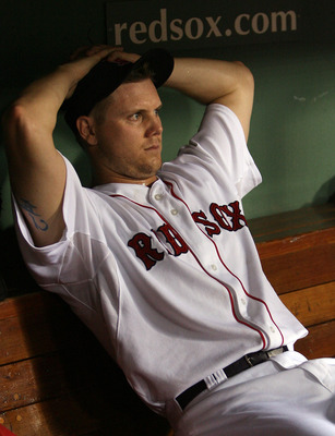 BOSTON - JULY 28:  Jonathan Papelbon #58 of the Boston Red Sox sits in the dugout after an error in the ninth inning against the Oakland Athletics at Fenway Park July 28, 2009 in Boston, Massachusetts.  (Photo by Elsa/Getty Images)