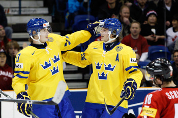 SASKATOON, SK - JANUARY 5:  David Rundblad #7 of Team Sweden celebrates his thrid period goal with teammate Carl Klingberg #17 of Team Sweden during the 2010 IIHF World Junior Championship Tournament Bronze Medal game on January 5, 2010 at the Credit Unio