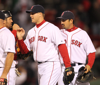 BOSTON, MA - APRIL 10: Jason Varitek #33, Jonathan Papelbon #58 and Adrian Gonzalez #28 of the Boston Red Sox celebrate a win against the New York Yankees at Fenway Park April 10, 2011 in Boston, Massachusetts. (Photo by Jim Rogash/Getty Images)