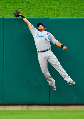 ST. LOUIS, MO - JUNE 18: Melky Cabrera #53 of the Kansas City Royals leap at the wall and catches a ball hit by Lance Berkman #12 of the St. Louis Cardinals at Busch Stadium on June 18, 2011 in St. Louis, Missouri.  (Photo by Jeff Curry/Getty Images)