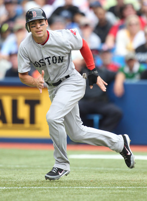 TORONTO, CANADA - JUNE 11:  Jacoby Ellsbury #2 of the Boston Red Sox takes off to second against the Toronto Blue Jays in a MLB game on June 11, 2011 at the Rogers Centre in Toronto, Ontario, Canada.  (Photo by Claus Andersen/Getty Images)