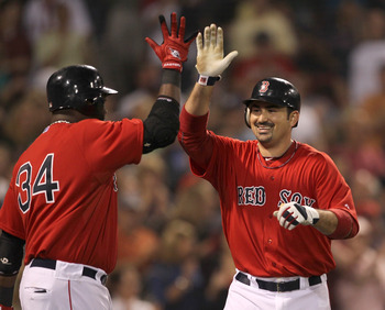 BOSTON, MA  - JUNE 17:  Adrian Gonzalez #28 of the Boston Red Sox celebrates his home run with teammate David Ortiz #34 in the fifth inning against the Milwaukee Brewers at Fenway Park on June 17, 2011 in Boston, Massachusetts.  (Photo by Jim Rogash/Getty