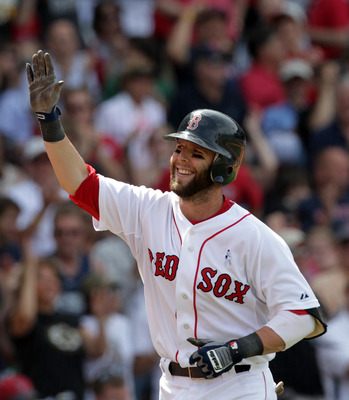 BOSTON, MA  - JUNE 19:  Dustin Pedroia #15 of the Boston Red Sox reacts after hitting a home run against of the Milwaukee Brewers at Fenway Park on June 19, 2011 in Boston, Massachusetts.  (Photo by Jim Rogash/Getty Images)