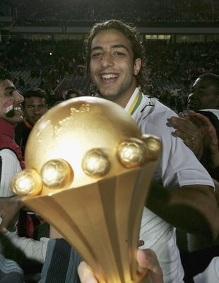 CAIRO, EGYPT - FEBRUARY 10: Mido of Egypt with the trophy after his country wins the The African Cup of Nations Final between Egypt and the Ivory Coast at The Cairo International Stadium on February 10, 2006 in Cairo, Egypt.  (Photo by Ben Radford/Getty I