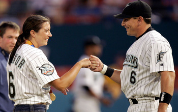 MIAMI - SEPTEMBER 17:  Olympic Gold Medalist in Beach Volleyball, Misty May, is greeted by her fiancee, Matt Treanor #6 of the Florida Marlins, after throwing the ritual first pitch before the start of the Florida Marlins against the Atlanta Braves on Sep