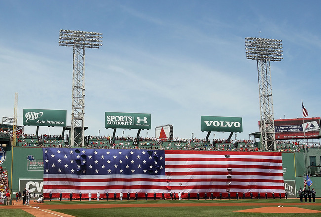 BOSTON - JULY 04:  Jets fly over as a giant flag covers the Green Monster before the game between the Baltimore Orioles and  the Boston Red Sox on July 4, 2010 at Fenway Park in Boston, Massachusetts.  (Photo by Elsa/Getty Images)