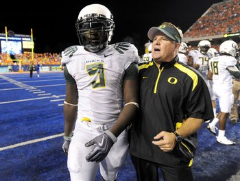 BOISE, ID - SEPTEMBER 3:  LaGarrette Blount #9 of the Oregon Ducks is escorted off the field by head coach Chip Kelly after Blount punched defensive end Byron Hout  #94 (not in photo)  of the Boise State Broncos after Boise State defeated Oregon 19-8 on S