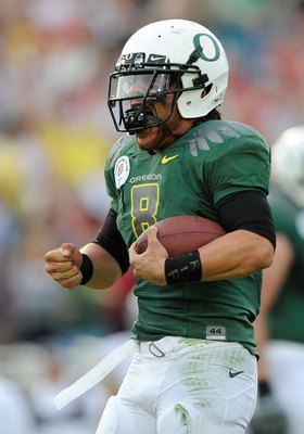 PASADENA, CA - JANUARY 01:  Quarterback Jeremiah Masoli #8 of the Oregon Ducks celebrates after scoring a touchdown against the Ohio State Buckeyes in the 96th Rose Bowl game on January 1, 2010 in Pasadena, California.  (Photo by Kevork Djansezian/Getty I