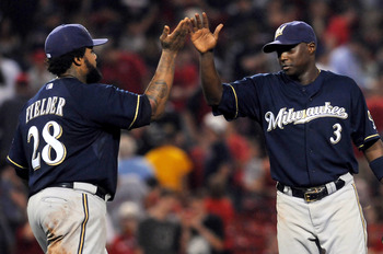 BOSTON, MA - JUNE 18:  Prince Fielder #28 and Yuniesky Betancourt #3 of the Milwaukee Brewers high five after their win against the Boston Red Sox at Fenway Park on June 18, 2011 in Boston, Massachusetts. The Brewers won the game 4-2. (Photo by Darren McC