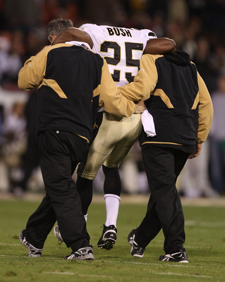 SAN FRANCISCO - SEPTEMBER 20:  Reggie Bush #25 of the New Orleans Saints is helped off the field after being injured against the San Francisco 49ers during an NFL game at Candlestick Park on September 20, 2010 in San Francisco, California.  (Photo by Jed
