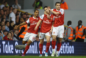 LONDON, ENGLAND - APRIL 20:  Samir Nasri of Arsenal celebrates scoring their second goal with team mates Robin van Persie and Theo Walcott during the Barclays Premier League match between Tottenham Hotspur and Arsenal at White Hart Lane on April 20, 2011