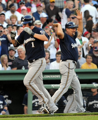 BOSTON, MA - JUNE 18:  Corey Hart #1 of the Milwaukee Brewers gets a high five from third base coach Garth Lorg after hitting a homerun in the first inning against the Boston Red Sox at Fenway Park on June 18, 2011 in Boston, Massachusetts. (Photo by Darr