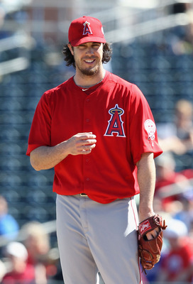 SURPRISE, AZ - MARCH 02:  Starting pitcher Dan Haren #24 of the Los Angeles Angels of Anaheim during the spring training game against the Texas Rangers at Surprise Stadium on March 2, 2011 in Surprise, Arizona.  (Photo by Christian Petersen/Getty Images)