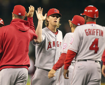SEATTLE - JUNE 14:  Starting pitcher Jered Weaver #36 of the Los Angeles Angels of Anaheim celebrates with teammates after throwing a complete game 4-0 shutout against the Seattle Mariners at Safeco Field on June 14, 2011 in Seattle, Washington. (Photo by