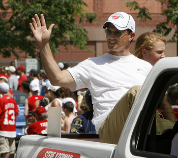 DETROIT - JUNE 06: Steve Yzerman vice president of the Detroit Red Wings reacts to fans during a parade to celebrate winning the 2008 Stanley Cup on June 6, 2008 in Detroit, Michigan.  (Photo by Gregory Shamus/Getty Images)