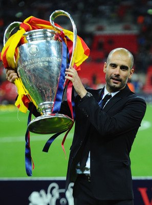 LONDON, ENGLAND - MAY 28:  Josep Guardiola manager of FC Barcelona lifts the trophy after victory in the UEFA Champions League final between FC Barcelona and Manchester United FC at Wembley Stadium on May 28, 2011 in London, England.  (Photo by Clive Maso