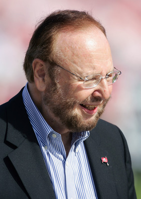 TAMPA, FL - JANUARY 1:  Owner Malcolm Glazer of the Tampa Bay Buccaneers stands on the sideline during the game with the New Orleans Saints at Raymond James Stadium on January 1, 2006 in Tampa, Florida. The Buccaneers defeated the Saints 27-13 to win the