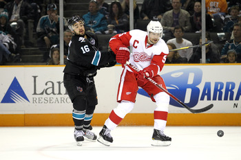 SAN JOSE, CA - MAY 08:  Devin Setoguchi #16 of the San Jose Sharks and Nicklas Lidstrom #5 of the Detroit Red Wings go for the puck in Game Five of the Western Conference Semifinals during the 2011 NHL Stanley Cup Playoffs at HP Pavilion on May 8, 2011 in