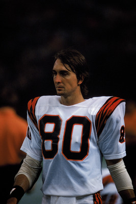 HOUSTON - 1985:  Wide receiver Cris Collinsworth #80 of the Cincinnati Bengals walks on the field during a game in the 1985 NFL Season against the Houston Oilers at the Houston Astrodome in Houston, Texas.  (Photo by Tony Duffy/Getty Images)